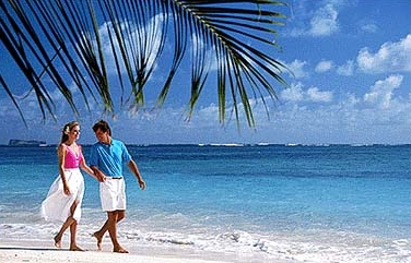 couple walking on a Belize beach